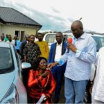 Governor Fayose watches as school principal kneels down to receive car gift from him
