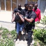 Man high on drugs begs police to shoot him after climbing roof (PHOTOS)