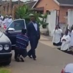 Viral photos of church members kneeling down to welcome their pastor