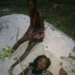 Woman caught allegedly trying to behead her daughter in Delta State (photos)