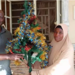 Muslim woman decorates Pastor's house with Christmas trees ahead of Christmas in Kaduna