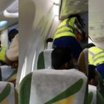 Drama as Nigerian man refuses to alight from plane in Malawi; struggles with officials