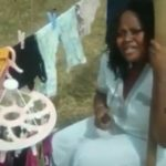 Nigerian lady monitors her panties with cutlass while sun drying them (Photos)