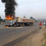 Dangote Trucks Destroyed As Driver Kills Young Apprentice In Delta (Photos)