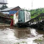 Photos: Trailer Driver Crashes Into River After Destroying Bridge In Bayelsa