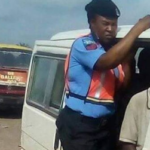 Policewoman 'turns conductor' in Lagos State. (Photos)