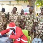 Nigerian Soldier Turns Father Christmas On Christmas Day. Gives Out Food Items (Photos)