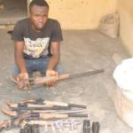 Man Arrested With Guns Concealed In Bag Of Garri