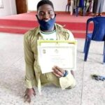 PHOTOS: 'Ability In Disability! Physically Challenged Man Smiles For The Camera After Completing His NYSC