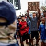 South Africa arrests two police officers for teen's murder