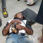 Traders In Awe As 'Well Dressed' Man Falls Asleep Near Bridge At Idumota In Lagos