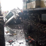 Passengers Narrowly Escape Death As Bus Collides With Moving Train In Lagos (photos)