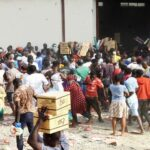 VIDEO: Abuja Residents Loot Another COVID-19 Palliatives Warehouse