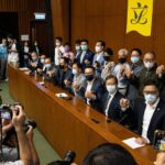 Hong Kong pro-democracy lawmakers resign as Beijing moves to quash opposition