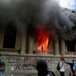 Protesters set fire to Guatemala's Congress to demand president resign