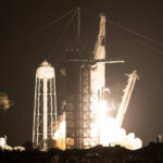 Full crew of astronauts on SpaceX capsule docks with International Space Station