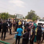 PHOTOS: Parents Of Abducted Students Block Airport Road, Give Govt 48 Hours To Effect Rescue In Kaduna