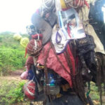 PHOTOS: People's Pictures, Personal Belongings Found Tied To A Tree At A Shrine Discovered In Abia Community