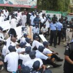 PHOTOS: Protesters Storm National Assembly, Evict Policemen, Demand To See Senate President, Speaker