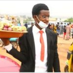 Meet The Young Nigerian Man Who Goes Hawking While Wearing Suits (Video)